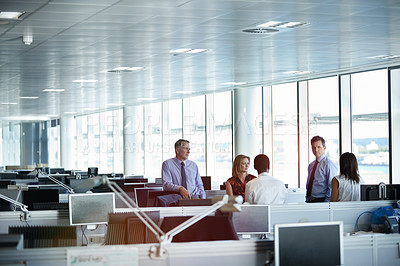 Buy stock photo Shot of a group of businesspeople talking together in an office