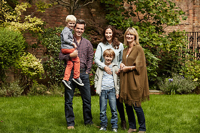 Buy stock photo Portrait of a smiling multigenerational family standing together outside