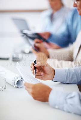 Buy stock photo Cropped image of hand of young business man checking the financial figures during a meeting