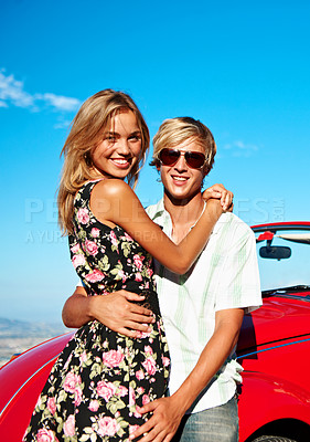 Buy stock photo Portrait of an affectionate young couple on a road trip to the beach