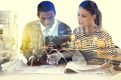 Buy stock photo Multiple exposure shot of two young colleagues working in the office superimposed over a city