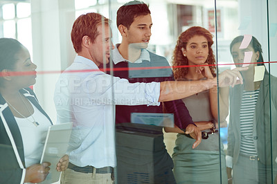 Buy stock photo Shot of a group of colleagues brainstorming in an office