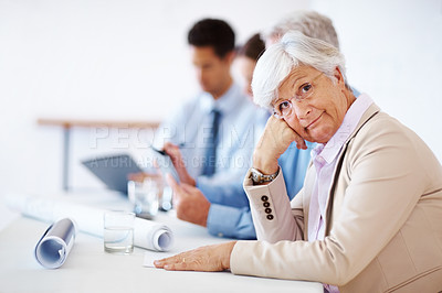 Buy stock photo Portrait of a old business woman sitting in a meeting and getting bored