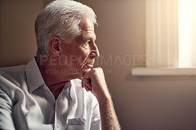 Buy stock photo Shot of a senior man looking thoughtful