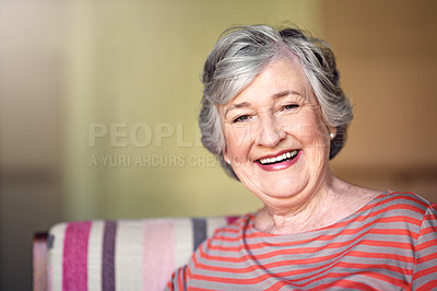 Buy stock photo Shot of a senior woman relaxing at home