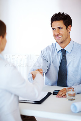Buy stock photo Portrait of a smart young male business entrepreneur shaking hand with colleague at office