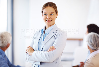 Buy stock photo Portrait of a successful young businesswoman standing with folded hands at office