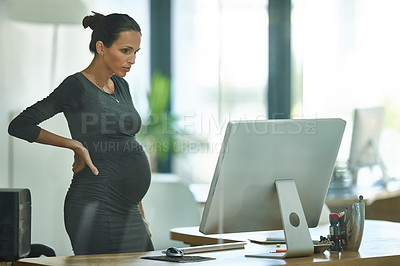 Buy stock photo Shot of a pregnant businesswoman working in an office