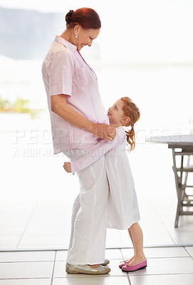 Buy stock photo Full length of a happy granddaughter hugging her grandmother