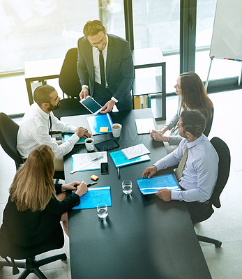 Buy stock photo Shot of a team of executives having a formal meeting in a boardroom