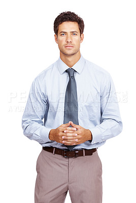 Buy stock photo Smart young businessman standing with hands clasped together against white background