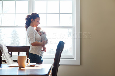 Buy stock photo Shot of a mother holding her newborn baby