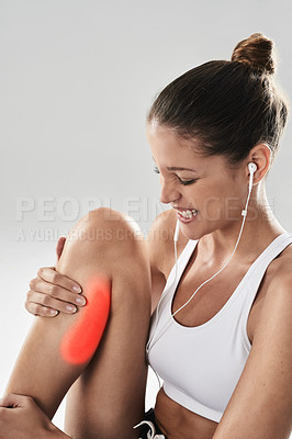 Buy stock photo Studio shot of an athlete with an injury highlighted in glowing red