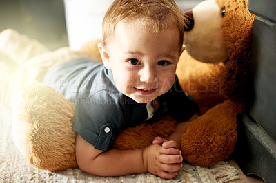 Buy stock photo Portrait of an adorable little boy playing with his teddy bear at home