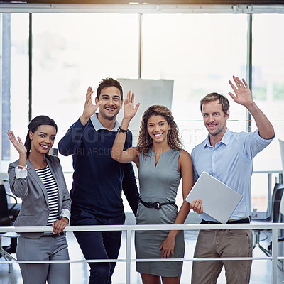 Buy stock photo Portrait of a group of colleagues waving together in an office