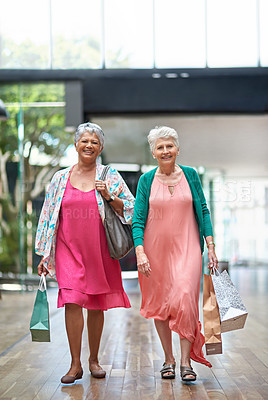 Buy stock photo Full length portrait of a two senior women out on a shopping spree