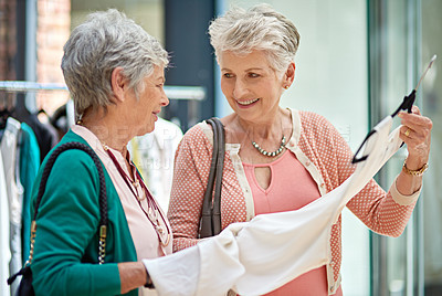 Buy stock photo Cropped shot of a two senior women out on a shopping spree