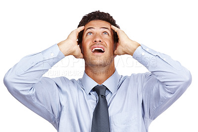 Buy stock photo Shocked and scared young business man looking upward with his hands on head isolated on white backgrpound