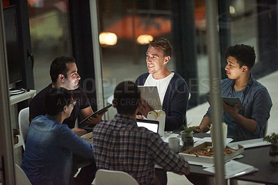 Buy stock photo Shot of employees working in an office at night