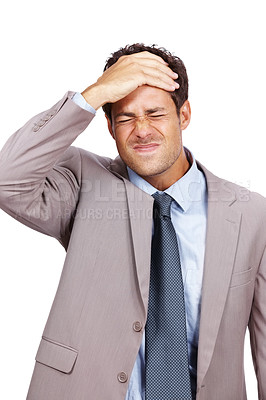 Buy stock photo Portrait of a depressed young businessman with his hand on head against white background