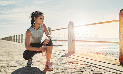 Buy stock photo Shot of a young sporty woman crouching outside