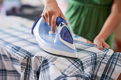 Buy stock photo Closeup of a woman ironing a shirt