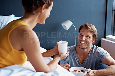 Buy stock photo Shot of a mature couple having breakfast in their bedroom