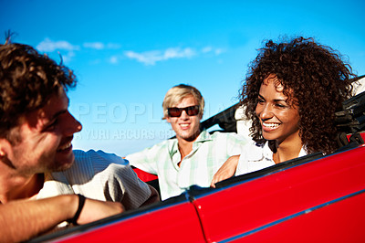 Buy stock photo Shot of a group of friends on a road trip