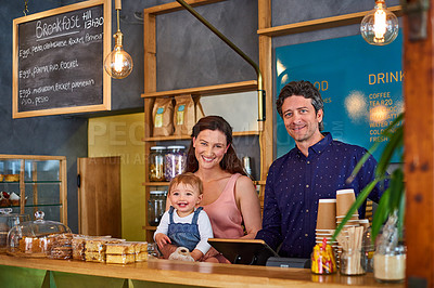 Buy stock photo Portrait of smiling couple and their little girl standing in their bakery