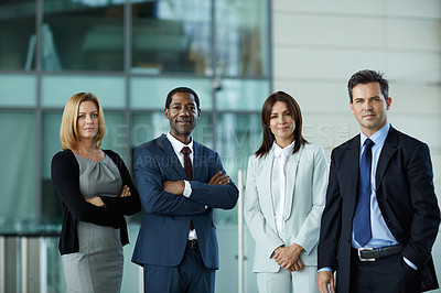 Buy stock photo Portrait of businesspeople standing together in the lobby of an office building