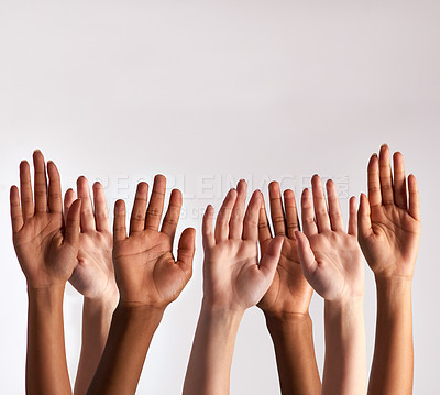 Buy stock photo Cropped shot of a diverse group of people raising their hands
