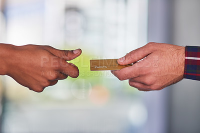 Buy stock photo Cropped shot of a customer giving his credit card to a store clerk
