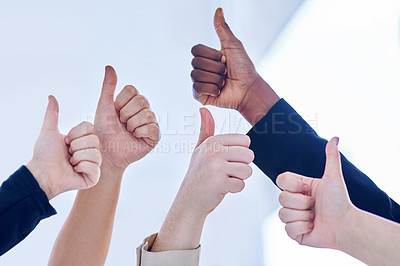 Buy stock photo Cropped shot of a group of businesspeople giving thumbs up in an office