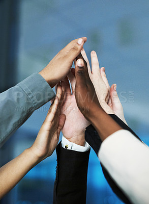 Buy stock photo Shot of a group of hands reaching up together