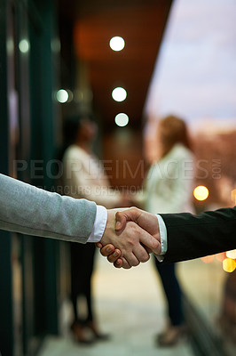 Buy stock photo Shot of businesspeople shaking hands
