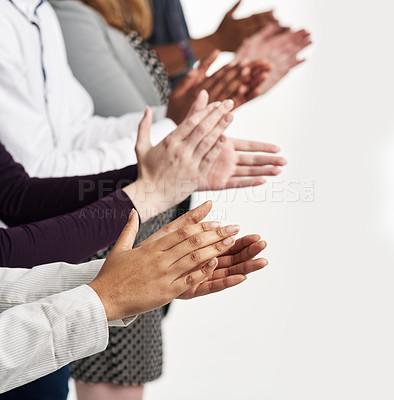 Buy stock photo Shot of a group of people clapping their hands together