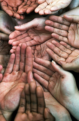 Buy stock photo Shot of a group of hands held cupped out together