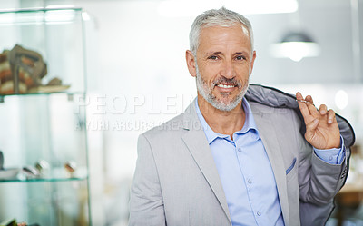 Buy stock photo Portrait of a mature man standing in a mall