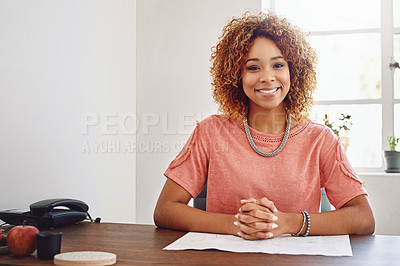 Buy stock photo Shot of a young designer sitting at her desk