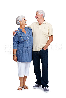 Buy stock photo Portrait of a smiling old couple looking at eachother isolated against white background