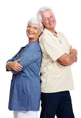 Buy stock photo Portrait of a happy old couple standing back to back and smiling isolated over white background