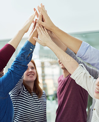 Buy stock photo Shot of a group of people putting their hands up together