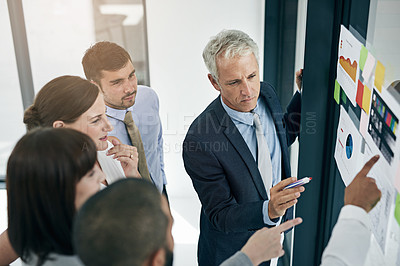 Buy stock photo Shot of a group of businesspeople having an office meeting