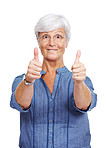 Excited senior lady showing thumbs up against white
