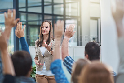 Buy stock photo Shot of a group of people raising their hands in a seminar