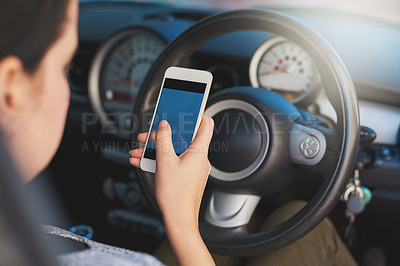 Buy stock photo Shot of a woman using a phone while driving