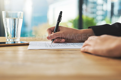 Buy stock photo Shot of a woman filling in some paperwork