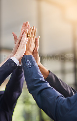 Buy stock photo Shot of a group of office workers giving each other a high five