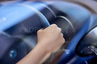 Buy stock photo Shot of hands holding onto a steering wheel while driving