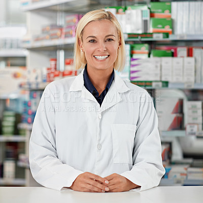 Buy stock photo Portrait of a pharmacist working in a drugstore. All products have been altered to be void of copyright infringements